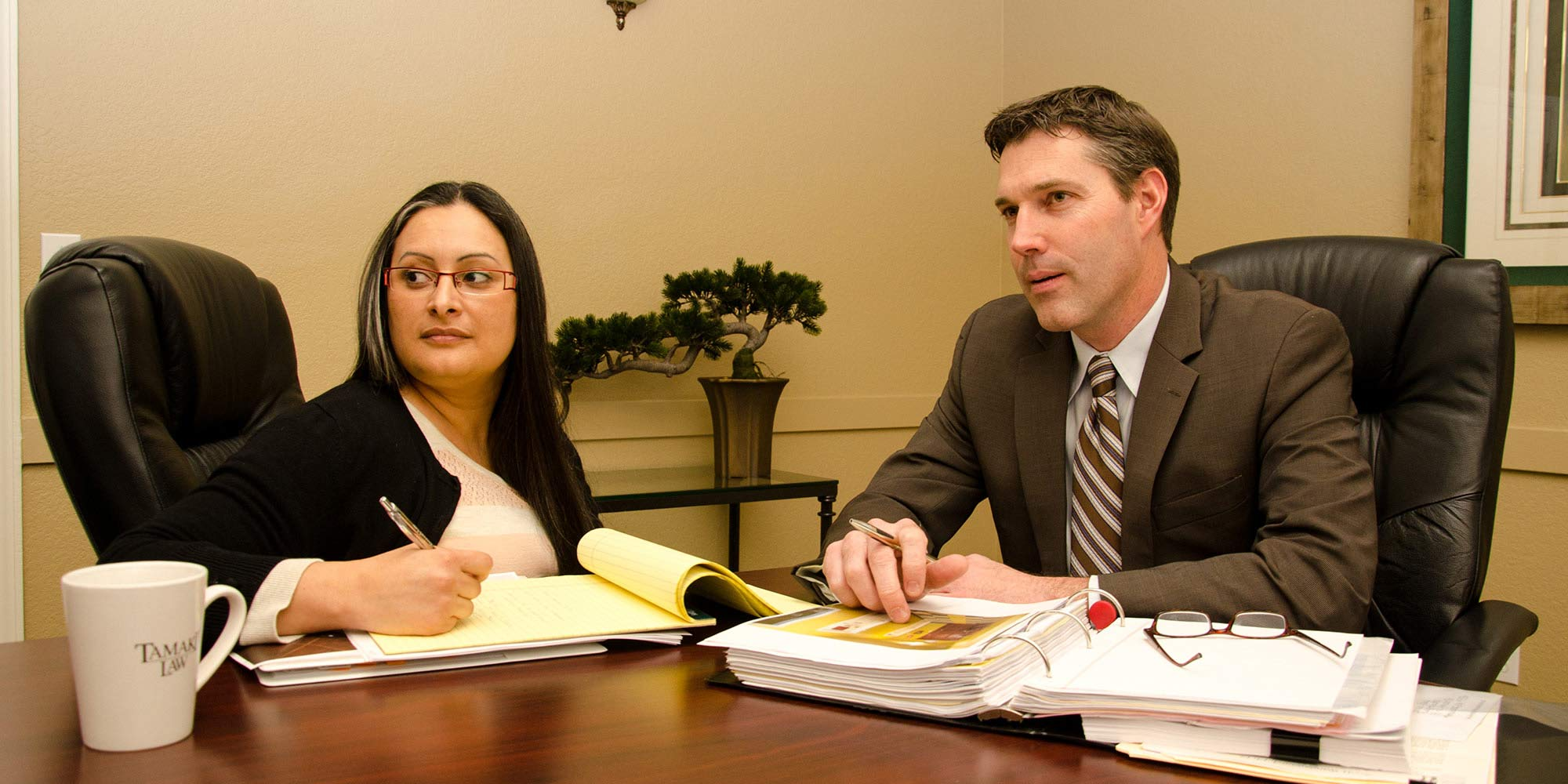 Jeff M. Kreutz and paralegal working together