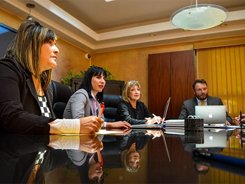 Lawyers collaborating at a conference table