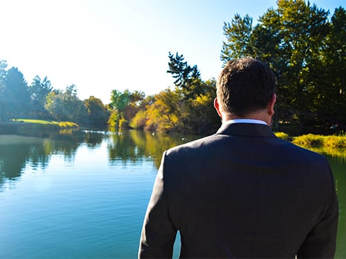 Lawyer looking out over a lake in Yakima