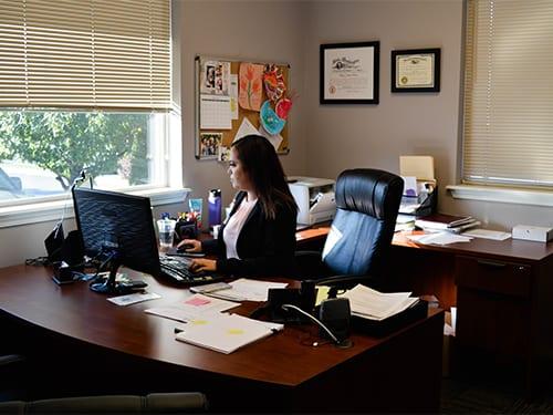 Megan Chang-Ngaruiya at her desk