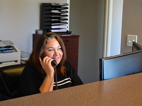 Cheryl Stockdill answering the phone at Tamaki Law