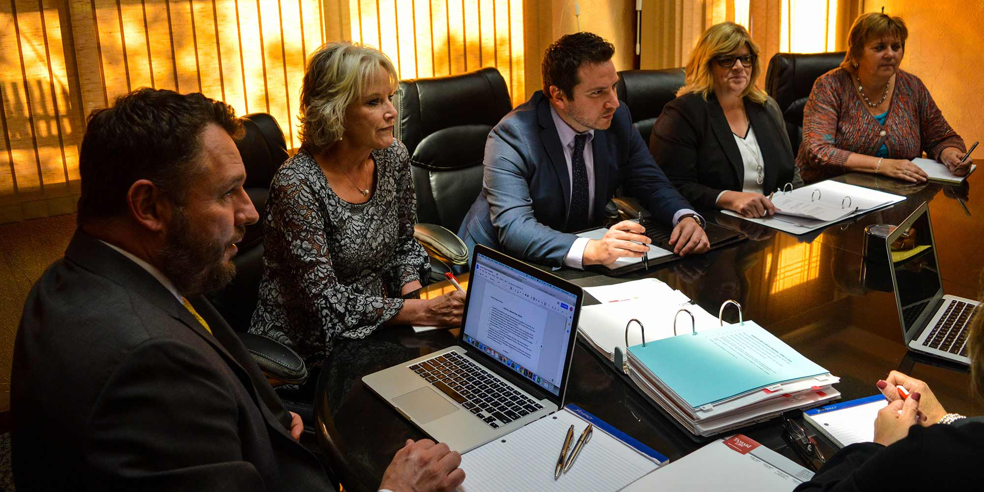 Tamaki legal team working together at a conference table