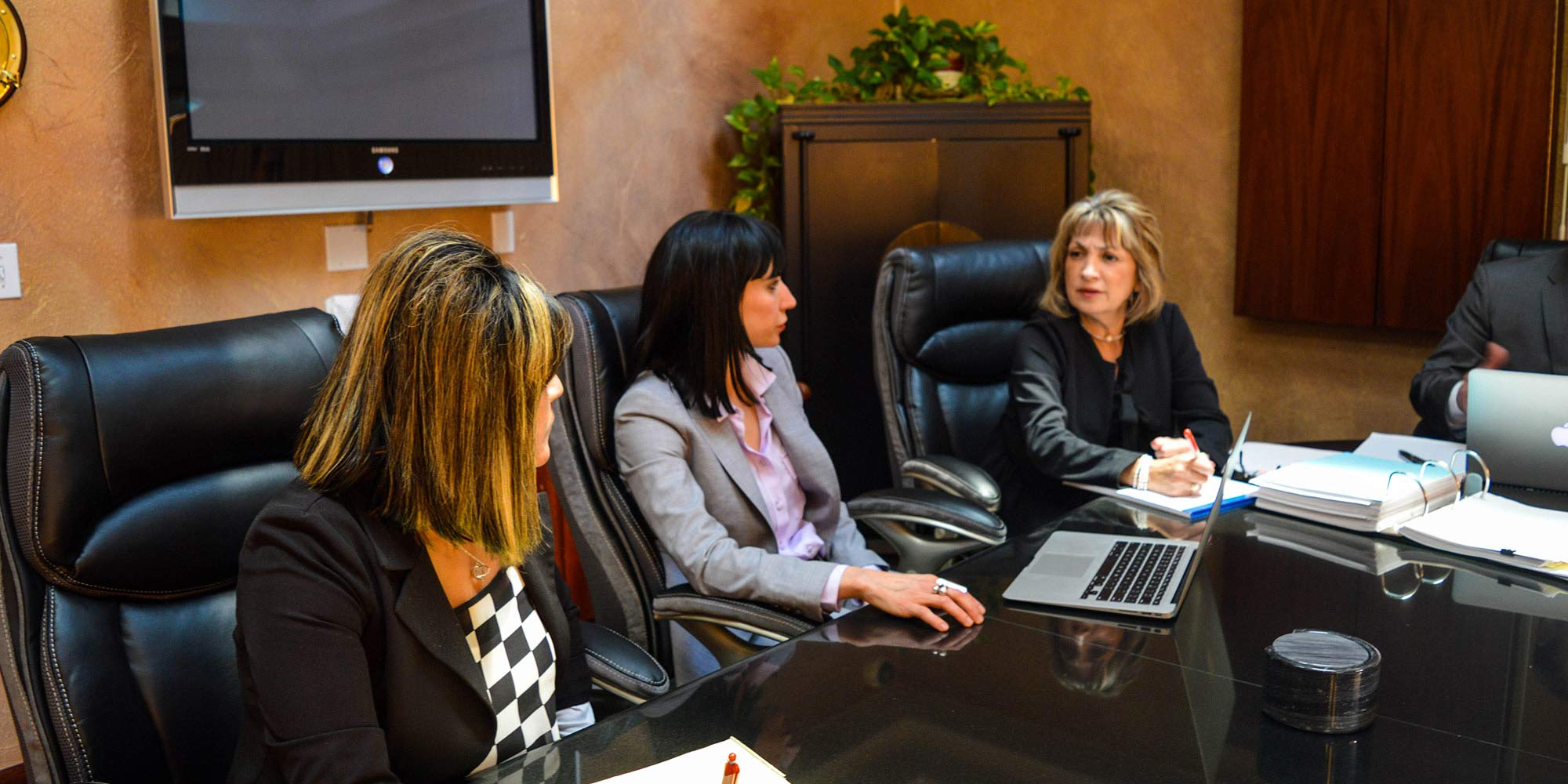 Tamaki legal team sitting at a conference table