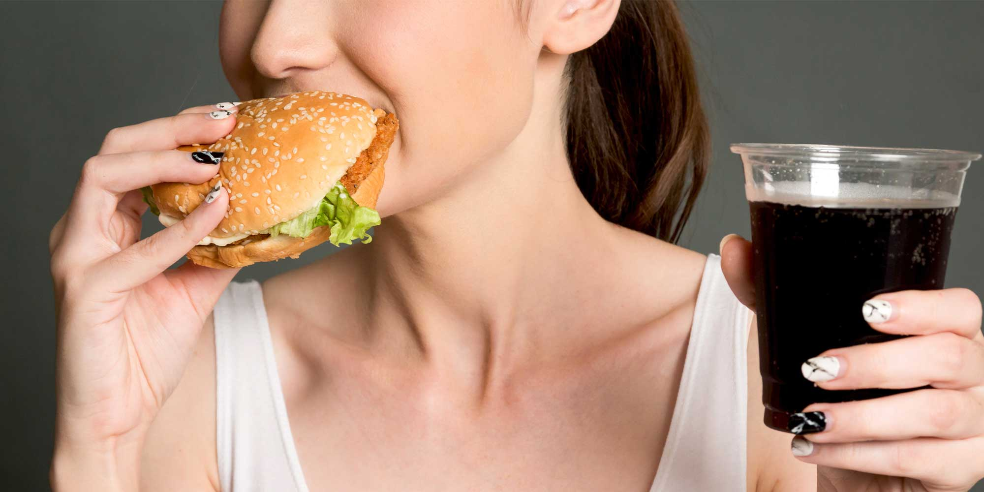 woman eating a chicken sandwich